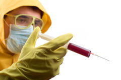Lab worker with a syringe Stock Images