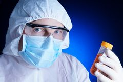 Lab worker testing a sample Stock Image