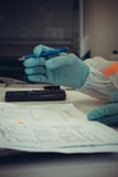 Lab worker writes analysis report for test Stock Photography
