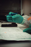 Lab worker writes analysis report for test Stock Image