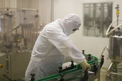 Laboratory worker in a protective suit, Poland 01.2013 royalty free stock photo