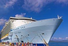 LABADEE, HAITI - MAY 01, 2018: Royal Caribbean, Oasis of the Seas docked in Labadee, Haiti on May 1 2018. LABADEE, HAITI - MAY 01, 2018: People going near Royal Stock Image