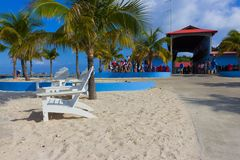 LABADEE, HAITI - MAY 01, 2018: People in lifejackets preparing for a water excursion on beach in Haiti. LABADEE, HAITI - MAY 01, 2018: People in lifejackets stock photo