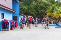 LABADEE, HAITI - MAY 01, 2018: People in lifejackets preparing for a water excursion on beach in Haiti. LABADEE, HAITI - MAY 01, 2018: People in lifejackets royalty free stock image