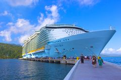 LABADEE, HAITI - MAY 01, 2018: Royal Caribbean, Oasis of the Seas docked in Labadee, Haiti on May 1 2018. LABADEE, HAITI - MAY 01, 2018: The people going to Stock Photography