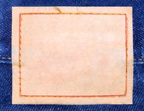 Label. One  brown label on blue jeans Royalty Free Stock Photo