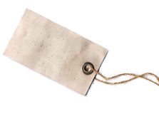 Label. Blank label hanging on a rope, made of old and stained paper Royalty Free Stock Photo