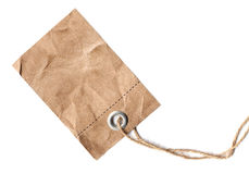 Label. Blank label hanging on a rope, made of old brown paper royalty free stock photos