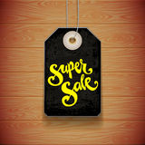 Label above a wooden surface. Tag Super Sale above a wooden surface. Vector illustration stock illustration