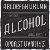 Label Alcohol appelé par oeil d'un caractère de vintage Photos stock