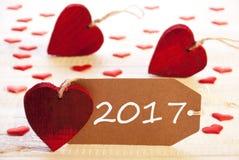 Label avec des beaucoup coeur rouge, texte 2017 Photos stock