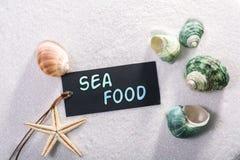 Label avec des fruits de mer image stock