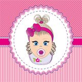 Label baby girl. With a pacifier with a bow and bib Stock Photography