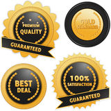 Label badges in black and gold Stock Image