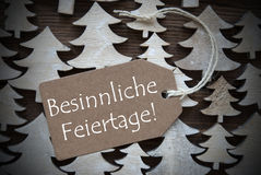 Label Besinnliche Feiertage Means Merry Christmas Stock Image