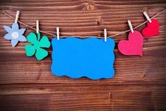 Label bleu avec l'espace de copie et coeurs et une fleur Images libres de droits