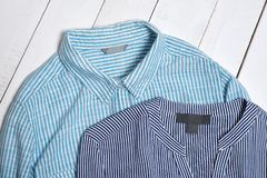 Label on blue striped cotton shirts. Fashion concept. Close up.  royalty free stock photography