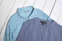 Label on blue striped cotton shirts. Fashion concept. Close up royalty free stock photography
