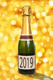 2019 on a label of a bottle of Champagne, golden background. 2019 on a label of a bottle of Champagne, shiny golden background stock illustration