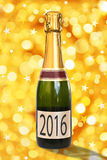 2016 on a label of a bottle of Champagne, shiny background Stock Image