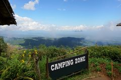 Label `Camping Zone` to Doi Mon Cham with mountain, sky, cloud and foggy stock photos