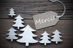 Label And Christmas Trees Merci Means Thank You Royalty Free Stock Photos