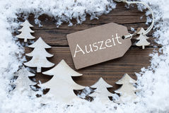 Label Christmas Trees Snow german Auszeit Means Downtime. Brown Christmas Label With Ribbon On Wooden  Background With White Christmas Trees And Snow. Vintage Royalty Free Stock Images