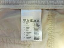 Label of clothing with marked materials and washing symbols stock images