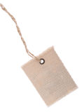 Label with cotton thread. On white background Royalty Free Stock Image