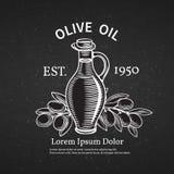 Label décoratif tiré par la main avec une bouteille d'huile Photo libre de droits