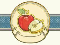 Label de pommes de cru sur le vieux textu de papier de fond Photo libre de droits