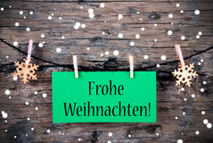 Label with Frohe Weihnachten, Snowy Background Stock Photo