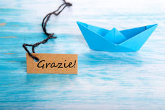 Label with Grazie and a Boat Stock Photo