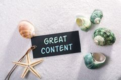 Label with great content. A natural looking label with great content written on it with sand and seashell and star Royalty Free Stock Image