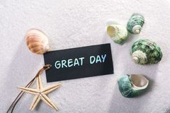 Label with great day. A natural looking label with great day written on it with sand and seashell and star Stock Photography