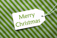 Label On Green Wrapping Paper, Text Merry Christmas Royalty Free Stock Images