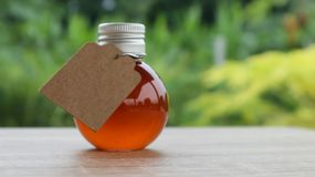 Honey in small bottle on blurred background Royalty Free Stock Photo