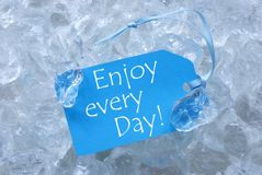 Label On Ice With Enjoy Every Day Royalty Free Stock Photos