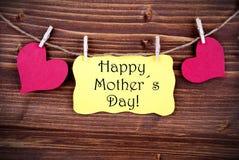 Label jaune avec le jour de mères heureux photographie stock