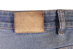 Label on jeans. Leather label on the side of old jeans stock image