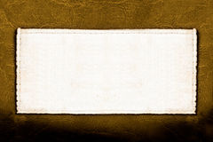 Label on leather. Blank fabric label on leather background close up Stock Photo