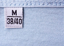 Label with M size. Close-up of clothing label with M size stock image