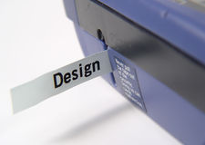 Label Machine. Photo of Label Machine With Label That Spells Design stock photo