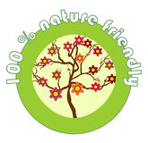 Label 100% nature friendly. For organic products with the flowering tree royalty free illustration