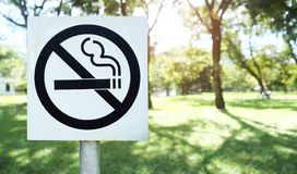 Label no smoking metal sign in the park Royalty Free Stock Photography