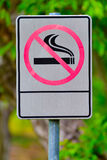 Label no smoking metal sign in the park Royalty Free Stock Photos