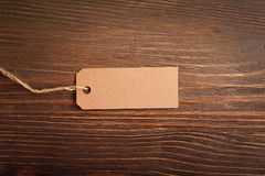 Label note on old wood background Stock Photos
