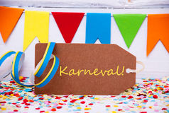 Label With Party Decoration, Text Karneval Means Carnival. Label With German Text Karneval Means Carnival. Party Decoration Like Streamer, Confetti And Bunting royalty free stock photos