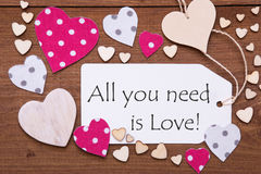 Label, Pink Hearts, Quote All You Need Is Love. One Label With English Quote All You Need Is Love. Flat Lay View With Wooden Vintage Background. Pink Wooden And Stock Photography