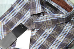 Label of Plaid shirts Stock Image